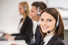 call-center-smiling-beautiful-lady-working-at-call-center-with-colleagues-in-office-stock-images_csp28338058